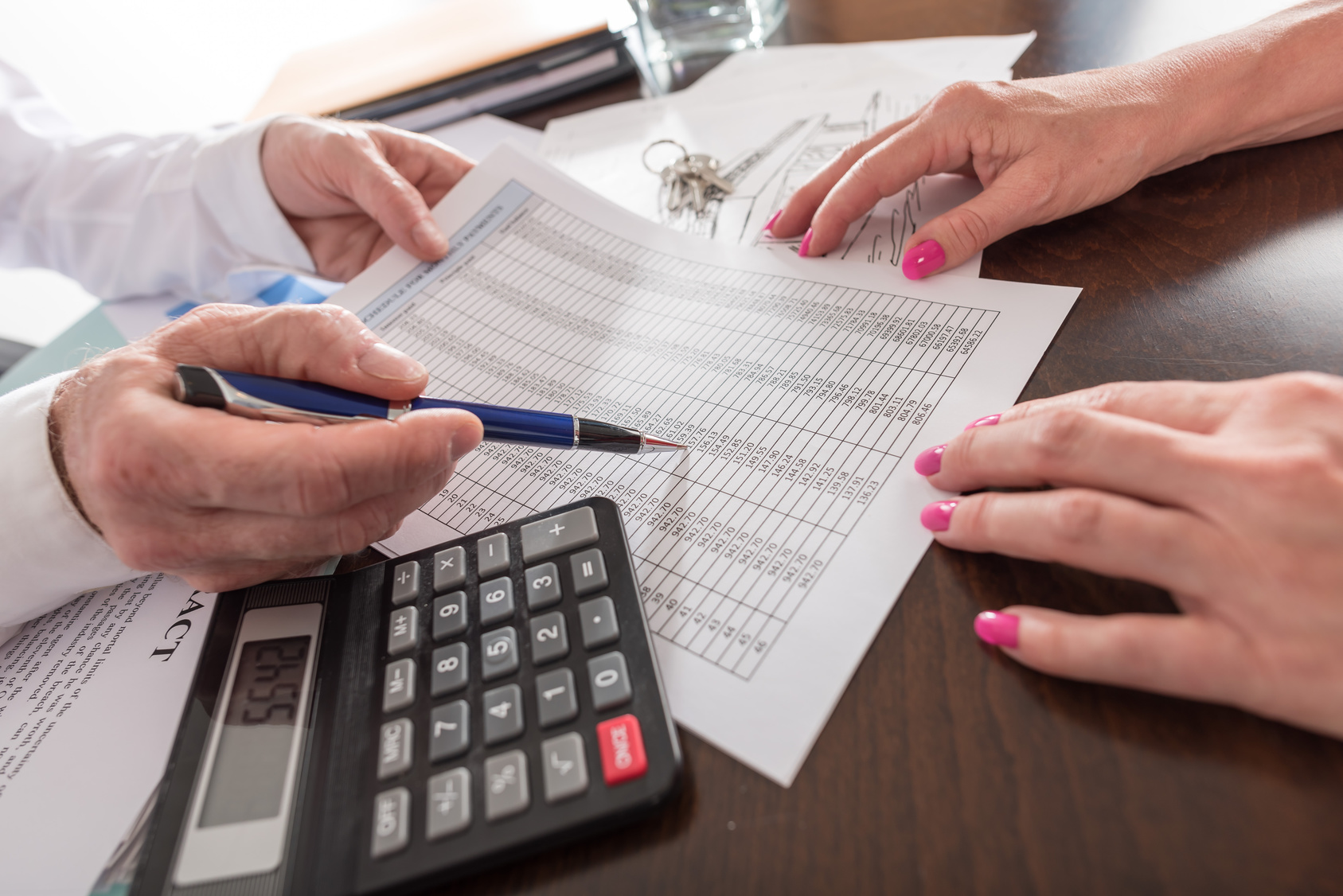 Estate agent showing a financial plan to his customer